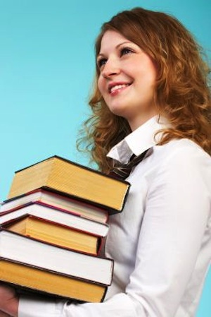 Woman stack of books