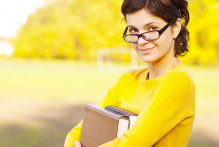 Smiling woman holding book