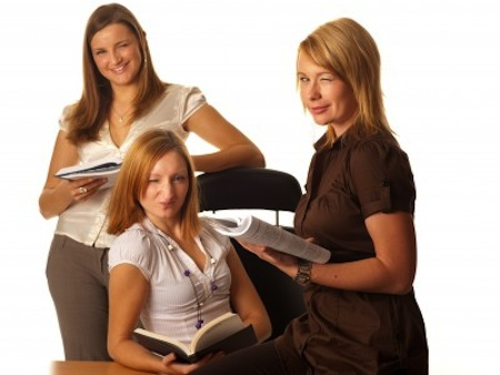 Three women reading books