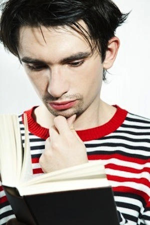 Man reading book and thinking