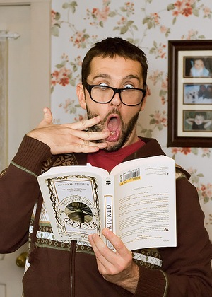 Shocked man reading book