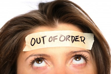 Out of Order sign on woman's forehead