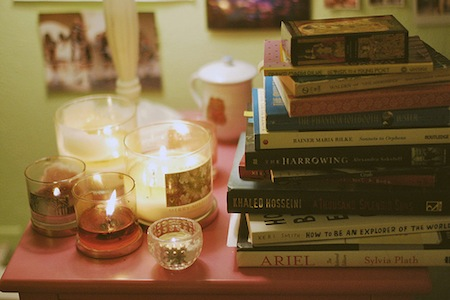 Candles and stack of novels