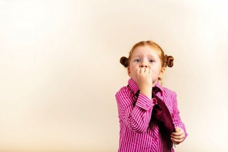 Shy little girl with red hair